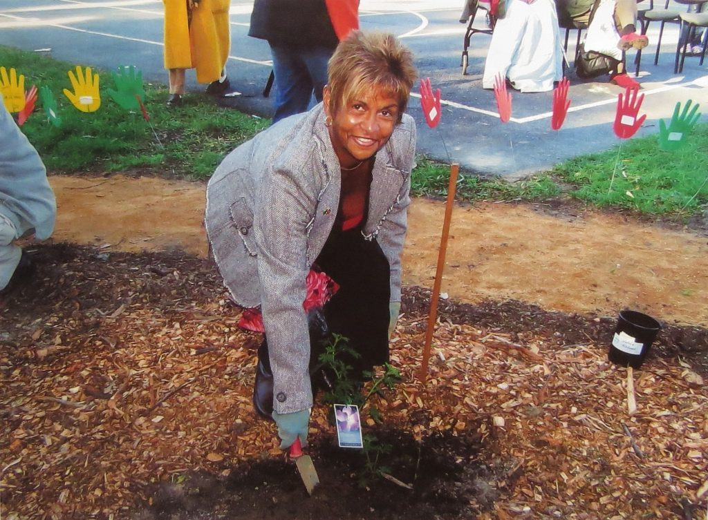 Pam Pederson planting at the opening ceremony 10 years ago